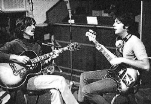 George Harrison, left, and Paul McCartney hammer out a song.